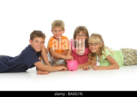 Group of children with piggy bank - Stock Photo