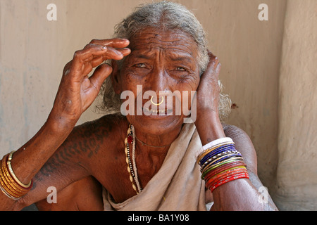 Elderly Indian Woman of the Paroja Tribe With Nose-ring and Tribal Tattoos, Orissa, India - Stock Photo
