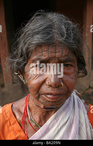 Portrait of Elderly Woman Of The Kutia Kondh Tribe With Facial Tattoos, Orissa, India - Stock Photo