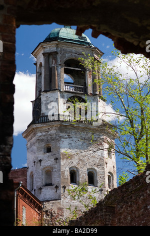 View on Vyborg clock tower through breach in wall. - Stock Photo