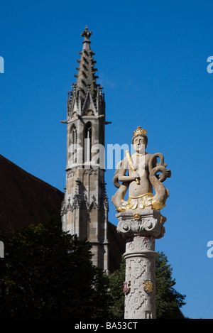 Herrnbrunnen in Herrngasse sandstone carved statue of woman with fish tails Rothenburg ob der Tauber Germany - Stock Photo