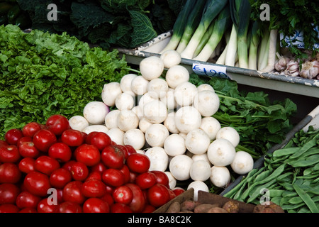 Various vegetables on display in the fruit and vegetable market in Funchal - Stock Photo