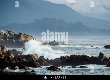 Waves colliding on rocks - Stock Photo