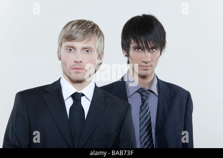 two male expressive young men on isolated background - Stockfoto