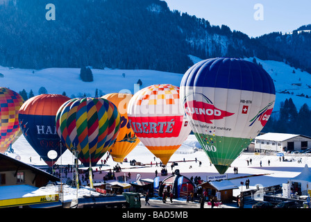 Hot air balloons being inflated in the staging area of the 2009 Chateau d'Oex International Ballon festival. Charles - Stock Photo