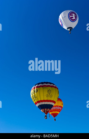 Hot air balloons rising into the clear blue sky at the 2009 Chateau d'Oex international balloon festival / races. - Stock Photo