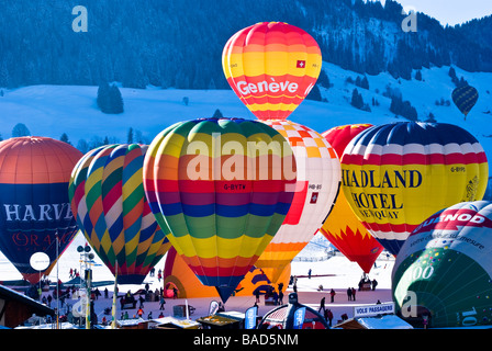 Hot air balloons being inflated in the staging area of the 2009 Chateau d'Oex International Balloon festival. Charles - Stock Photo