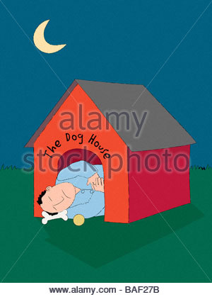 Sleeping In the Dog House - Stock Photo