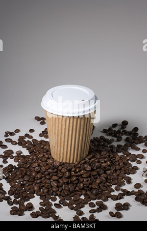 A paper cup on coffee beans - Stock Photo