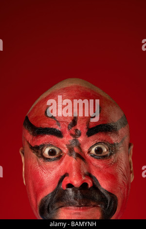 An Actor Portrays Guang Gong, Ancient Chinese General in Beijing Opera Costume, Represents Protection and Wealth - Stock Photo