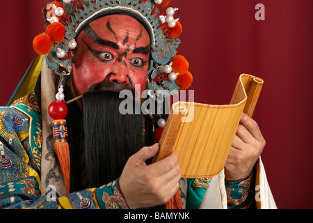 Guang Gong, Ancient Chinese General in Beijing Opera Costume, Represents Protection and Wealth - Stock Photo