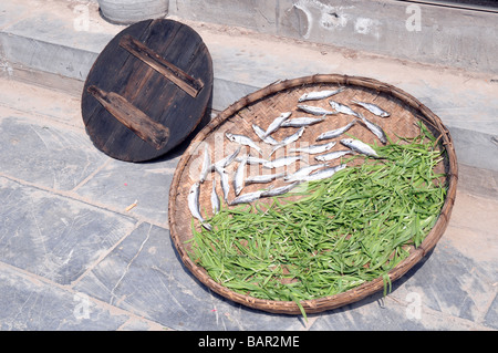 Sun dried fish and beans for sale on street in Sanhe, Anhui province, China. - Stock Photo