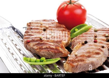 Grilled rumpsteak on aluminium grill pan - Stock Photo