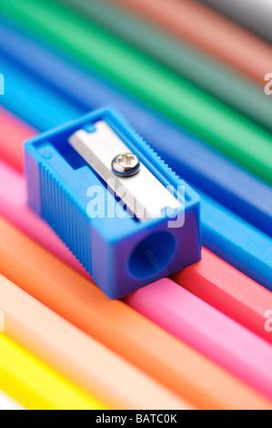 Colored pencils and pencil sharpener - Stockfoto