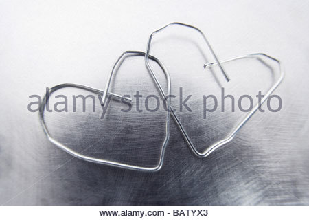 still life of two paper clips in shape of hearts - Stock Photo