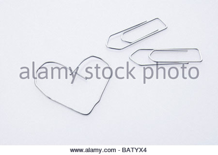 still life of three paper clips one in shape of heart - Stockfoto