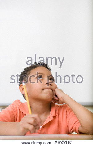Frustrated boy taking test - Stock Photo