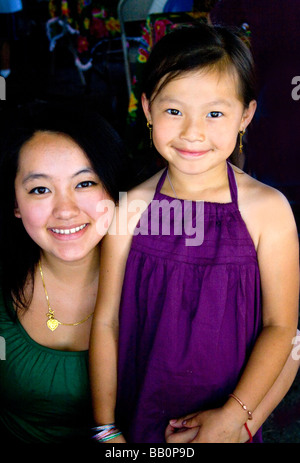 Happy Hmong mother and daughter enjoying the festival. Hmong Sports Festival McMurray Field St Paul Minnesota USA - Stock Photo