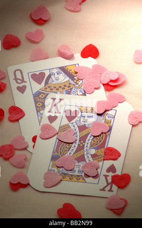 a pair of king and queen playing cards with love hearts - Stock Photo