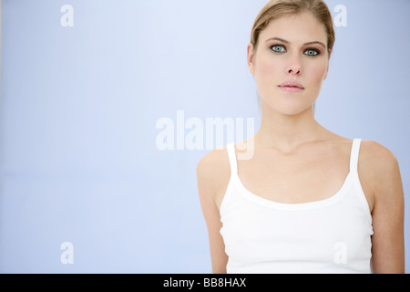Portrait of young beauty serious looking woman with make up - Stock Photo