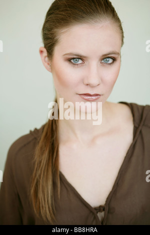 Portrait of young stylish woman with make up - Stock Photo