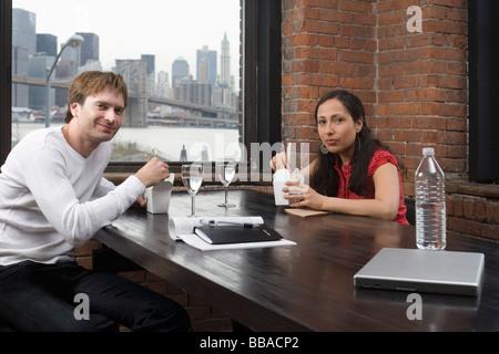 A couple having a business lunch - Stock Photo