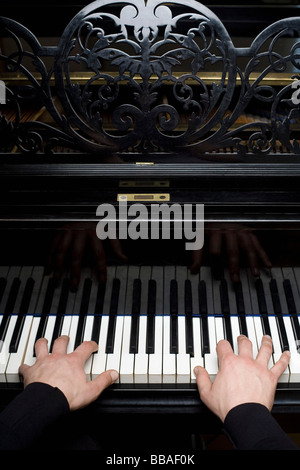 Human hands playing a piano - Stockfoto