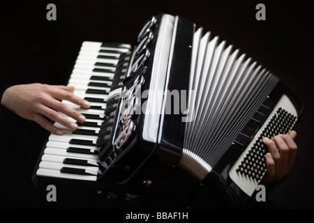 Human hands playing an accordion - Stockfoto