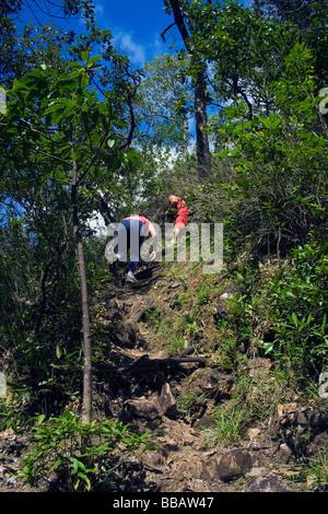 Trekkers on Agua Fria Waterfall Track Chapada dos Veadeiros Veadeiros Tableland Goias Brazil - Stock Photo