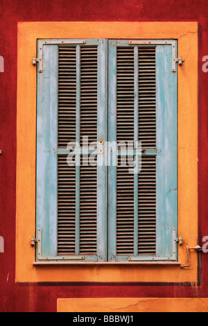 Typical French window on residential building in the Vielle Ville old town part of Nice France - Stock Photo