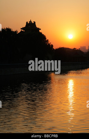 The forbidden City Moat in Beijing China at Sunset - Stock Photo