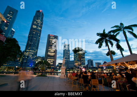 Skyline of Singapore  Raffles Statue street cafe South East Asia twilight Singapur - Stock Photo