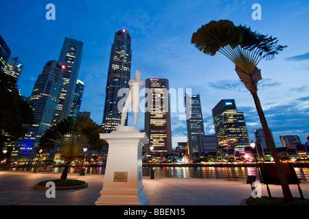 Skyline of Singapur Raffles Statue South East Asia twilight Singapore - Stock Photo