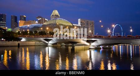 Skyline of Singapur Esplanade Marina Square big wheel at twilight South East Asia twilight - Stock Photo