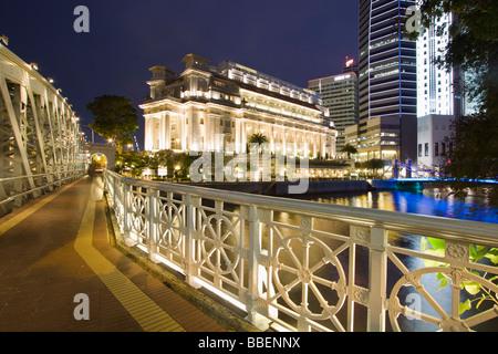 Cavenagh bridge Fullerton Hotel Skyline of Singapore  South East Asia twilight - Stock Photo