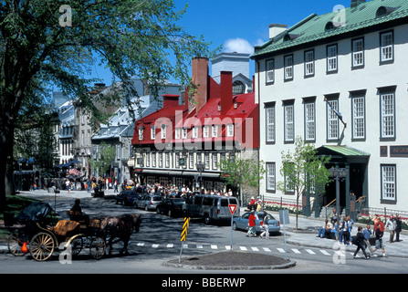 Sainte-Anne street in the Spring with tourists sitting on the terraces, Old Quebec City, Quebec - Stock Photo