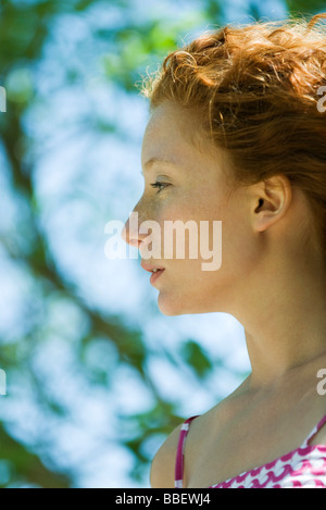 Young red haired woman in profile, portrait - Stock Photo