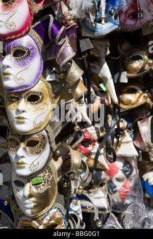 Venetian masks on a stall - Stock Photo