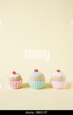 Knitted cupcakes - Stock Photo