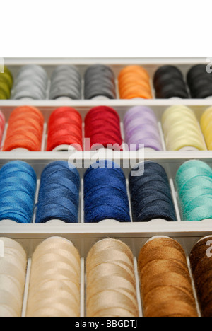 Spools of thread in various colours - Stock Photo