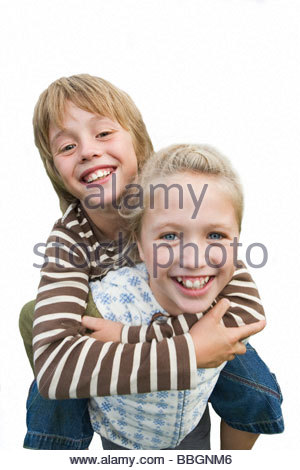Girl carrying boy by piggyback, smiling, close-up, portrait, cut out - Stock Photo
