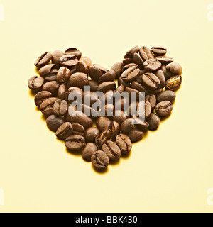 A heart shape of luxury coffee beans. - Stock Photo