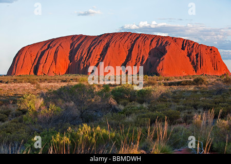 Australia, Northern Territory. Uluru or Ayres Rock, a huge sandstone rock formation. One of the most recognized - Stock Photo