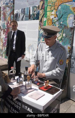 Passport stamping at Berlin Wall remains, Potsdamer Platz, Berlin, Germany - Stock Photo