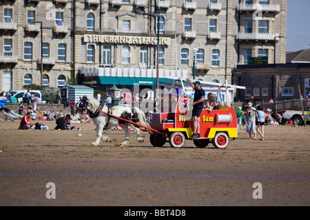 Pony Ride on Beach at Weston Super Mare Somerset England - Stockfoto