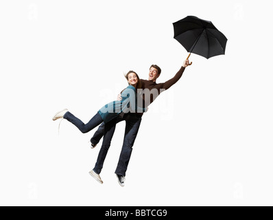 Couple being blown away - Stock Photo