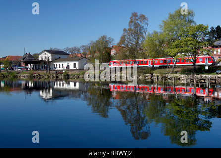 A regional train pulls into the main station on the shores of Lake Ploen, Ploen, Holstein Switzerland, Schleswig - Stock Photo