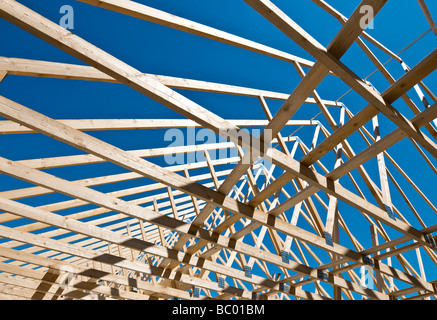 Shadows of a timber roof truss on a block wall stock photo for Prefabricated roof truss