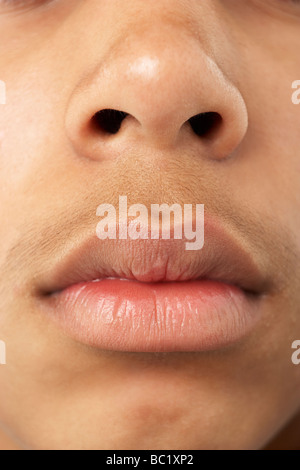 Close-Up Of Young Boy's Mouth And Nose - Stock Photo