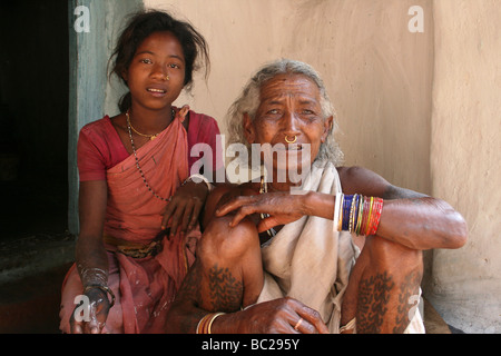 Elderly Indian Woman of the Paroja Tribe With Her Grandaughter, Orissa, India - Stock Photo
